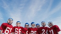 Pee wee football team (10-12) on field, low angle view
