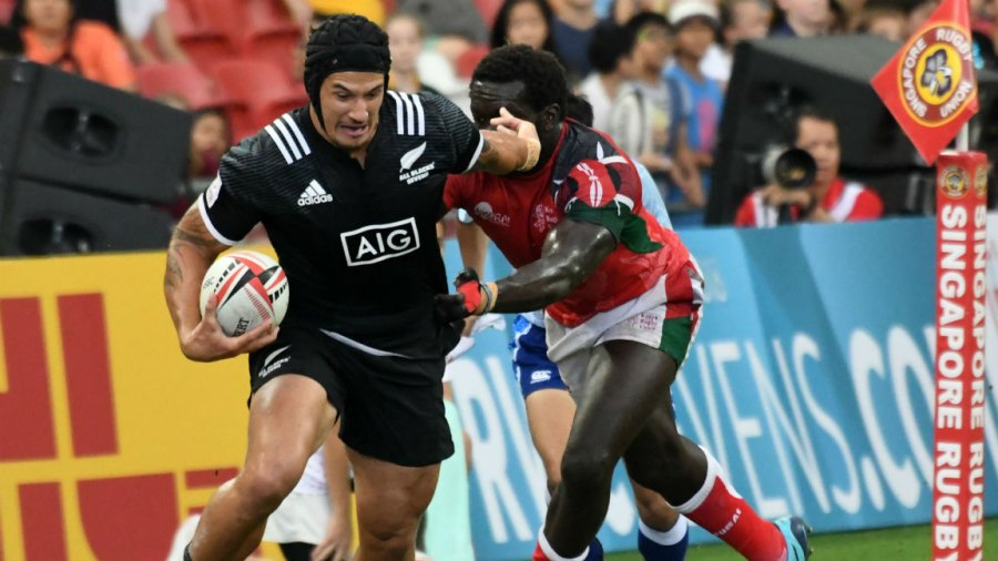 New Zealand's Trael Joass (L) runs with the ball against Kenya during the fifth place cup semi-final of the HSBC Singapore Rugby Sevens tournament in Singapore on April 29, 2018.