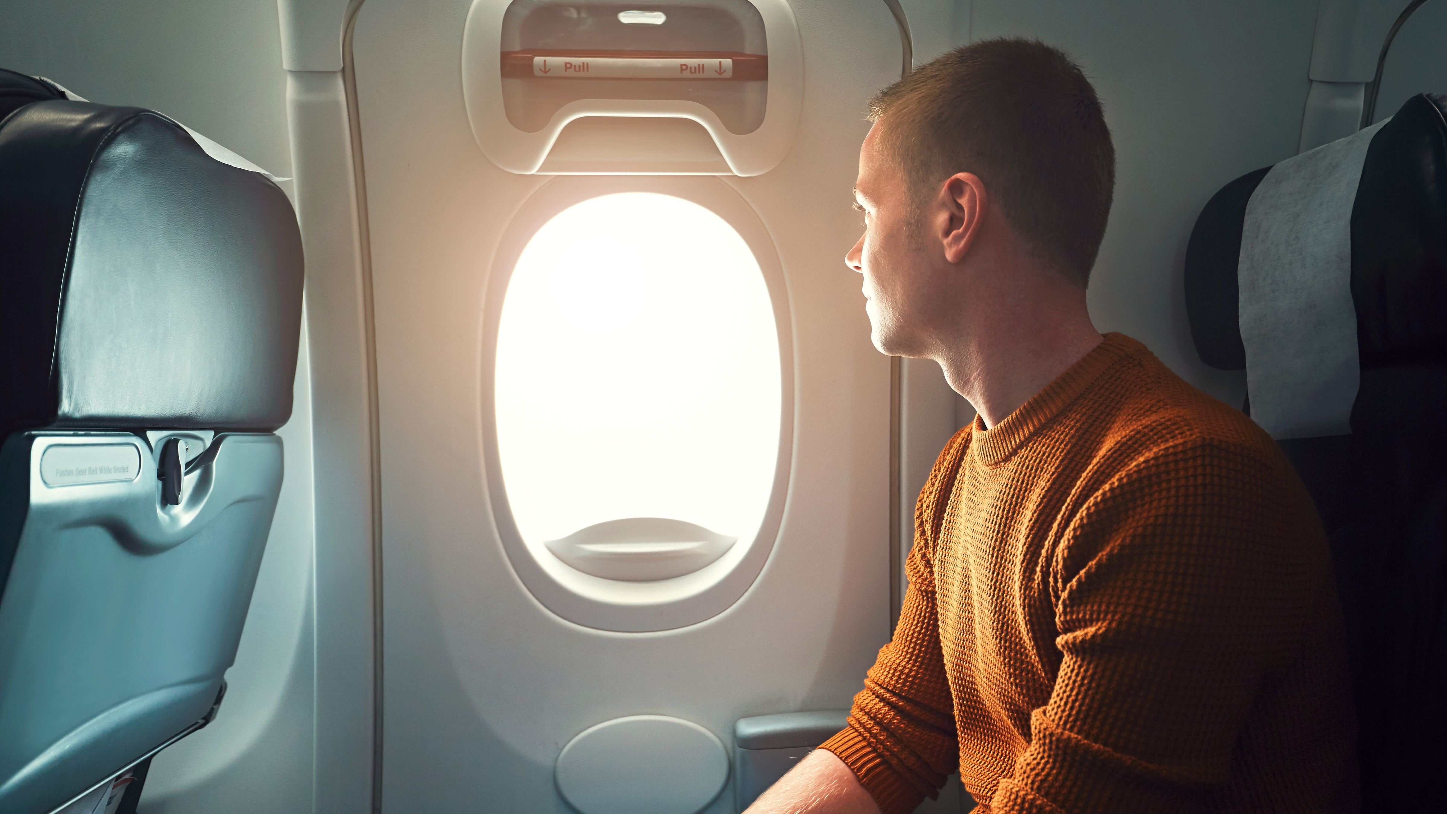 The Best Stretches You Can Do On a Plane