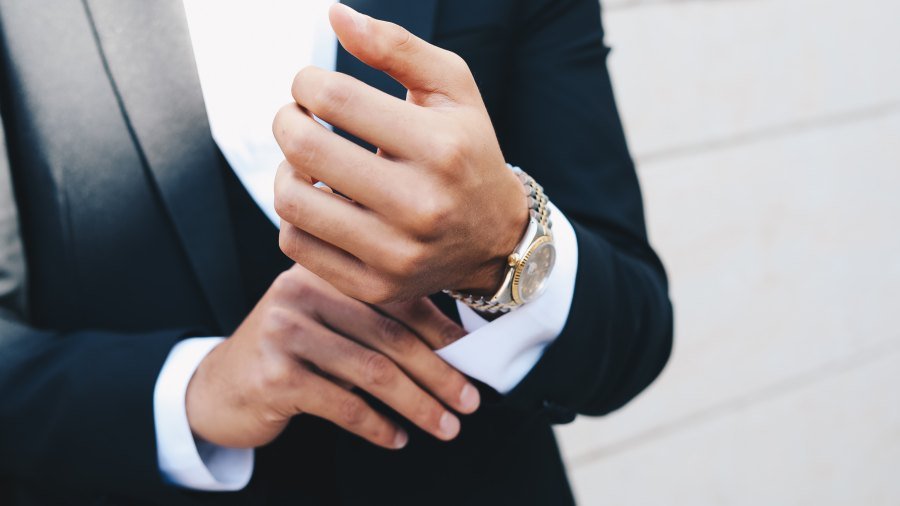 man in suit with watch
