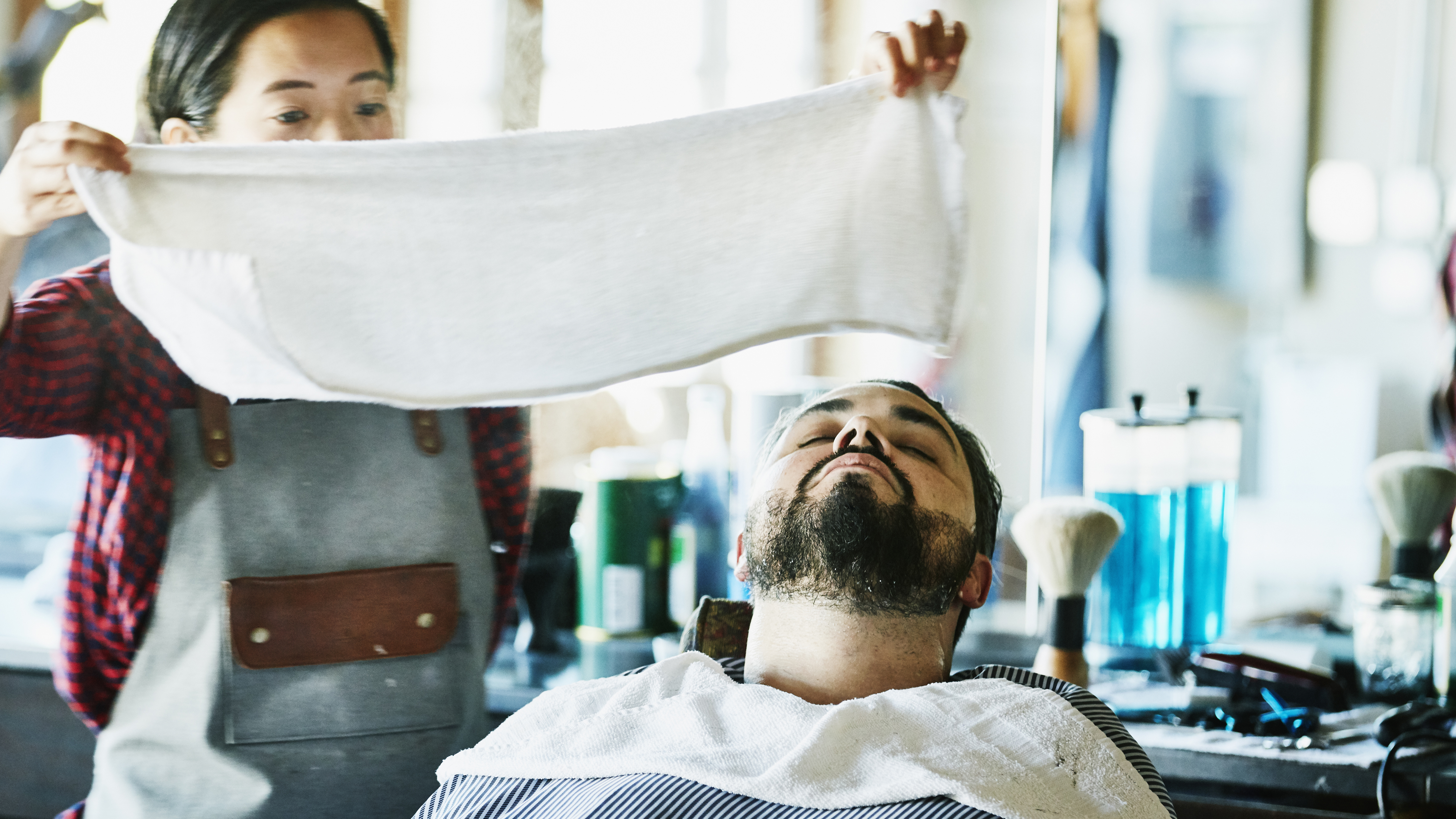 The Reason Your Barber Puts a Hot Towel on Your Face