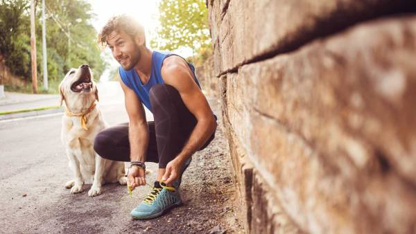 Young man jogging with his dog