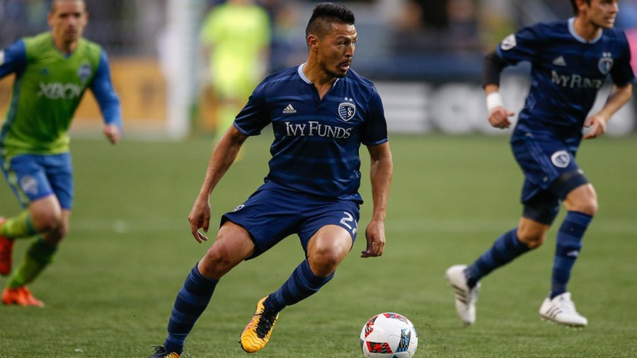 Roger Espinoza #27 of Sporting Kansas City dribbles against the Seattle Sounders FC at CenturyLink Field on March 6, 2016 in Seattle, Washington.