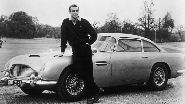 Actor Sean Connery, the original James Bond, is pictured here on the set of Goldfinger with one of the fictional spy's cars, a 1964 Aston Martin DB5.