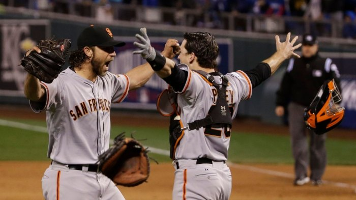 E Games of the Year Baseball, Kansas City, USA San Francisco Giants pitcher Madison Bumgarner, left, and Buster Posey celebrate after winning 3-2 to win the series over Kansas City Royals after Game 7 of baseball's World Series in Kansas City, Mo 29 Oct 2014 Image ID: 6113188a Featured in: YE Games of the Year Baseball, Kansas City, USA Photo Credit: Matt Slocum/AP/Shutterstock