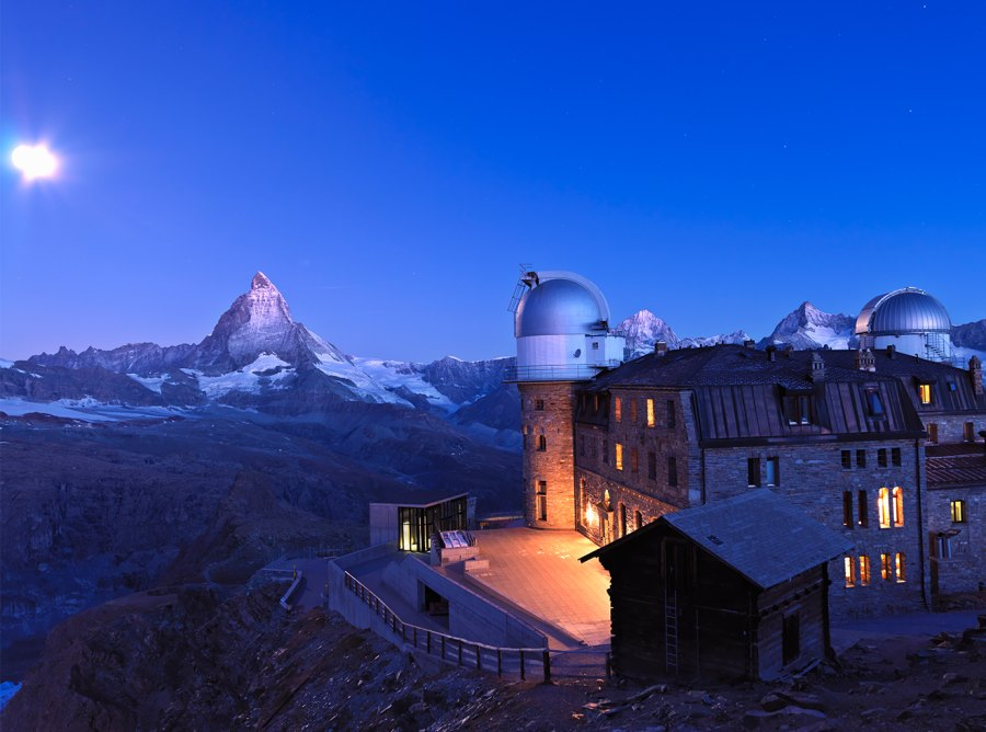 oon setting at dawn over the Matterhorn and the Kulmhotel at the Gornergrat