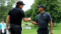 Phil Mickelson (L) and Tiger Woods meet during a preview day of the World Golf Championships - Bridgestone Invitational at Firestone Country Club South Course at on August 1, 2018 in Akron, Ohio.