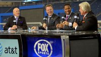 Curt Menefee, Terry Bradshaw, Howie Long, Michael Strahan and Jimmy Johnson (L-R) host the FOX television NFL Postgame Show from the sidelines after the game between the Green Bay Packers and the Detroit Lions at Ford Field on November 24, 2011 in Detroit, Michigan. The Packers defeated the Lions 27-15.