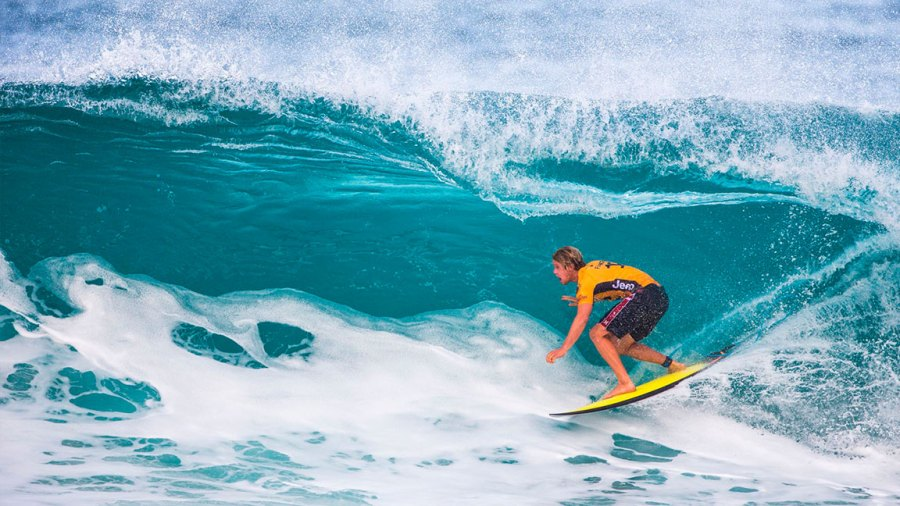 John-John Florence, current World Champion from Hawaii, gets into the tube on 'Backdoor' during the 1st round of the Billabong Pipe Masters, in Haleiwa, Hawaii on December 11, 2017. / AFP PHOTO / TOM SERVAIS (Photo credit should read TOM SERVAIS/AFP/Getty Images)