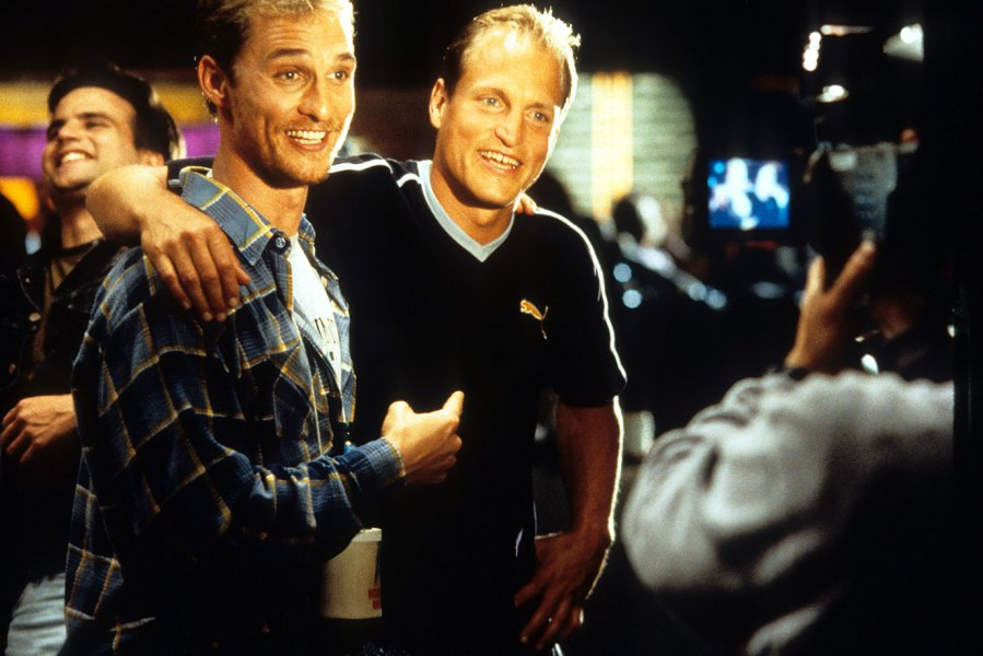 Matthew McConaughey and Woody Harrelson smiling before the camera in a scene from the film 'Edtv', 1999. (Photo by Universal/Getty Images)