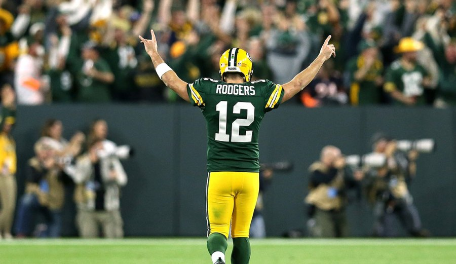 Aaron Rodgers #12 of the Green Bay Packers reacts after throwing a touchdown pass to Randall Cobb #18 during the fourth quarter of a game against the Chicago Bears at Lambeau Field on September 9, 2018 in Green Bay, Wisconsin. (Photo by Dylan Buell/Getty Images)
