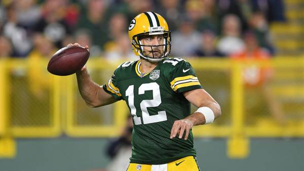 Aaron Rodgers #12 of the Green Bay Packers drops back to pass during a game against the Chicago Bears at Lambeau Field on September 9, 2018 in Green Bay, Wisconsin. (Photo by Stacy Revere/Getty Images)