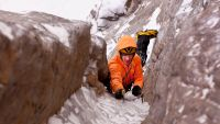 A male ice climber climbing the Ames Ice Hose,(WI5, M6) Ames, Colorado, USA