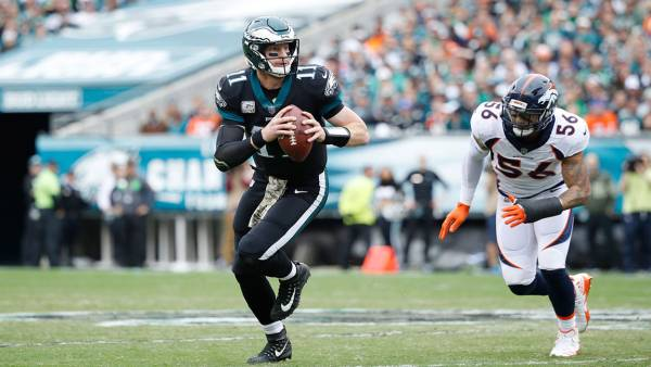 Carson Wentz #11 of the Philadelphia Eagles looks to pass while under pressure from Shane Ray #56 of the Denver Broncos during a game at Lincoln Financial Field on November 5, 2017 in Philadelphia, Pennsylvania. The Eagles defeated the Broncos 51-23. (Photo by Joe Robbins/Getty Images)