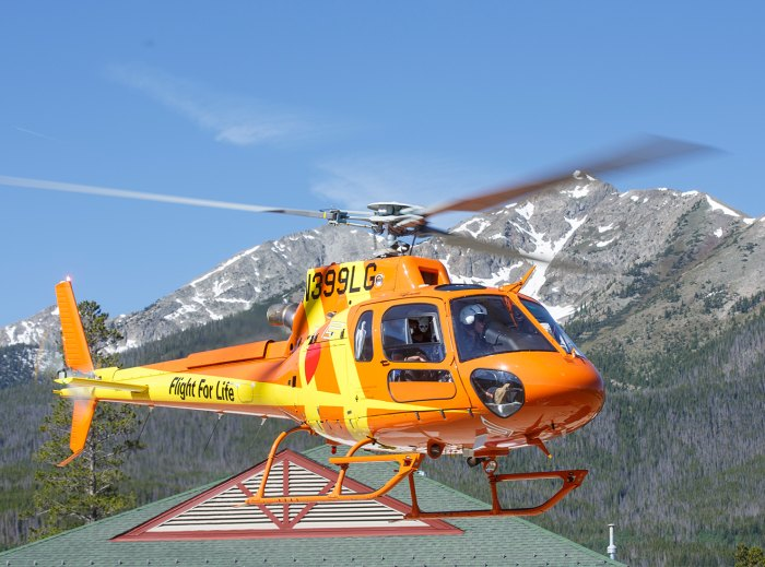 An Airbus AS350 B3e takes off from a helipad in Frisco, Colorado.