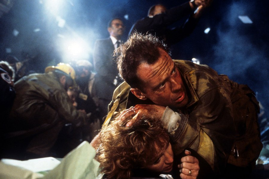 Bonnie Bedelia is held down by Bruce Willis in a scene from the film 'Die Hard', 1988. (Photo by 20th Century-Fox/Getty Images)