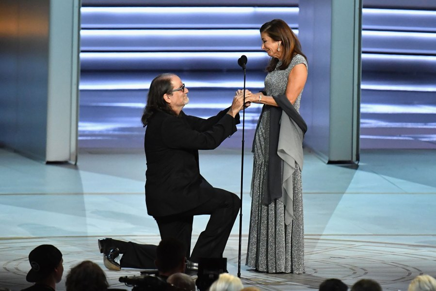 Glenn Weiss (L), winner of the Outstanding Directing for a Variety Special award for 'The Oscars,' proposes marriage to Jan Svendsen onstage during the 70th Emmy Awards at Microsoft Theater on September 17, 2018 in Los Angeles, California. (Photo by Jeff Kravitz/FilmMagic)
