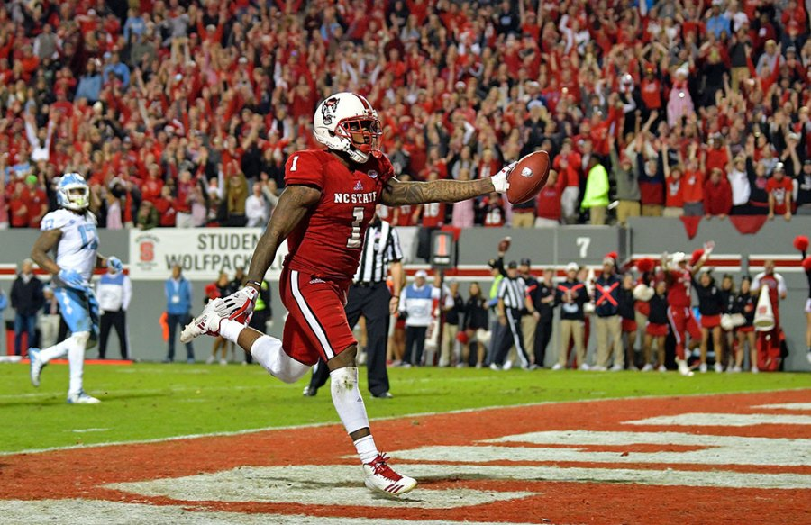Jaylen Samuels #1 of the North Carolina State Wolfpack scores the game-clinching touchdown late in the fourth quarter of their game against the North Carolina Tar Heels at Carter Finley Stadium on November 25, 2017 in Raleigh, North Carolina. North Carolina State won 33-21. (Photo by Grant Halverson/Getty Images)