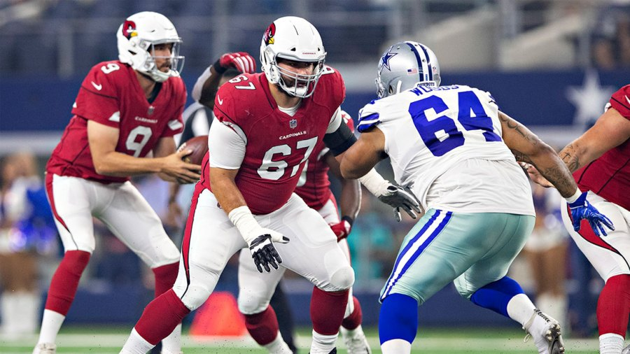 Justin Pugh #67 of the Arizona Cardinals drops back to block Antwaun Woods #64 of the Dallas Cowboys at AT&T Stadium during week 3 of the preseason on August 26, 2018 in Arlington, Texas. The Cardinals defeated the Cowboys 27-3. (Photo by Wesley Hitt/Getty Images)