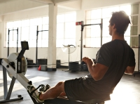 Man working out using rowing machine