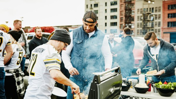 Men grilling at football tailgate