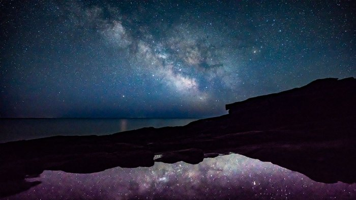 The Milky Way shines above the ocean off the coast of Acadia National Park in the early morning hours of Monday, April 23, 2018. Night skies in northern Maine consistently place first in a rating of darkness, meaning there is less light pollution and allowing more stars and planets to be seen. Parks like Acadia, Katahdin Woods & Waters National Monument as well as the Appalachian Mountain Club, which has land holdings in the 100-mile wilderness area, are hoping to boost astrotourism by becoming receiving a dark-sky designation from the International Dark-Sky Association. (Staff photo by Gregory Rec/Portland Press Herald via Getty Images)