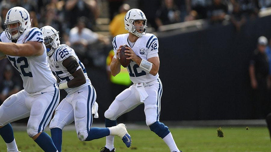 Andrew Luck #12 of the Indianapolis Colts looks ot pass against the Oakland Raiders during the first quarter of their NFL football game at Oakland-Alameda County Coliseum on October 28, 2018 in Oakland, California. (Photo by Thearon W. Henderson/Getty Images)