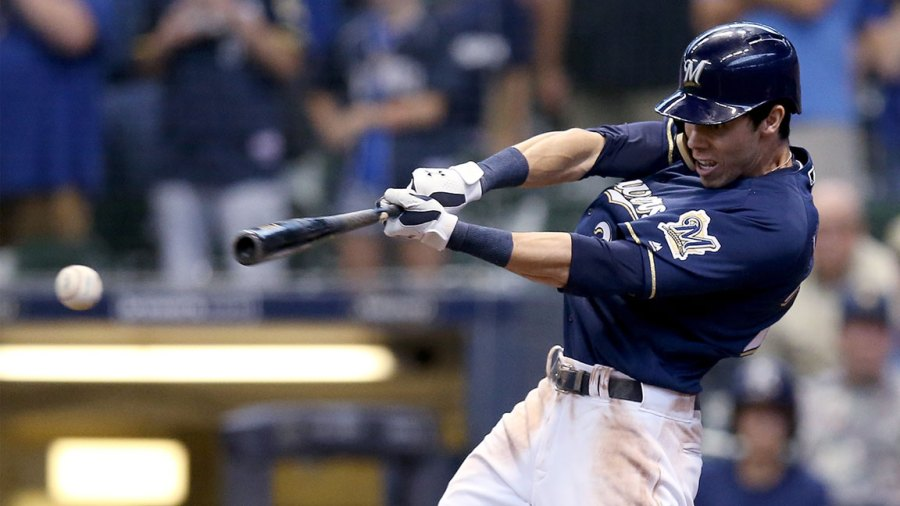 Christian Yelich #22 of the Milwaukee Brewers hits a fielder's choice to beat the Chicago Cubs 4-3 at Miller Park on September 3, 2018 in Milwaukee, Wisconsin. (Photo by Dylan Buell/Getty Images)