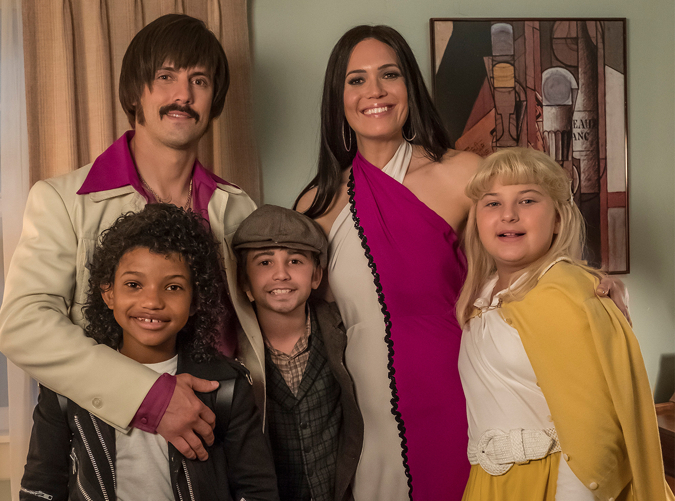 Ventimiglia (upper left) channels his inner Sonny Bono as Jack Pearson on This is Us, co-starring (clockwise from upper right) Mandy Moore, Mackenzie Hancsicsak, Parker Bates, and Lonnie Chavis