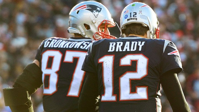 Rob Gronkowski #87 of the New England Patriots reacts with Tom Brady #12 after catching a touchdown pass during the third quarter of a game against the Miami Dolphins at Gillette Stadium on November 26, 2017 in Foxboro, Massachusetts. (Photo by Adam Glanzman/Getty Images)