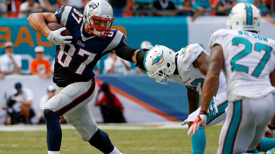 Rob Gronkowski #87 of the New England Patriots stiff-arms Jamar Taylor #22 of the Miami Dolphins during the second half of the game Sun Life Stadium on September 7, 2014 in Miami Gardens, Florida. (Photo by Rob Foldy/Getty Images)