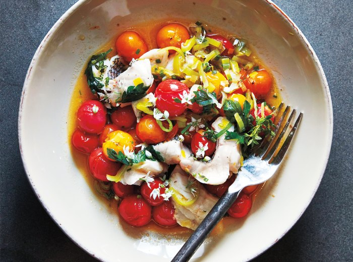 Sea bass with leeks and cherry tomatoes.