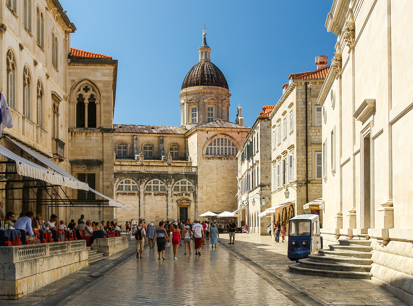 Tourists strolling near the cathedral in the Old City of Dubrovnik, Croatia