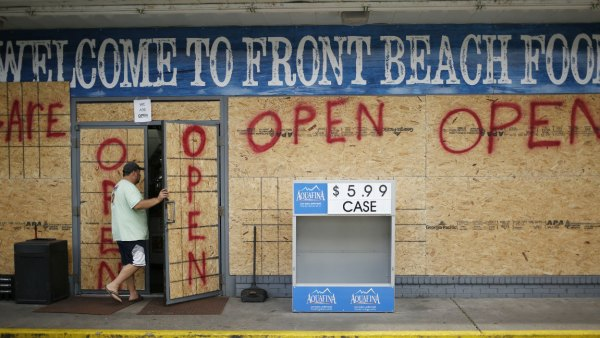 A customer enters a boarded up gas station ahead of Hurricane Michael in Panama City Beach, Florida, U.S., on Tuesday, Oct. 9, 2018. Michael, a Category 2 hurricane, is racing toward the Florida panhandle and is forecast to become thesecond stormto make U.S. landfall in a month. Photographer: Luke Sharrett/Bloomberg via Getty Images