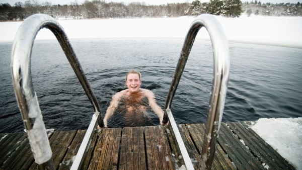 Plunging in pond during winter