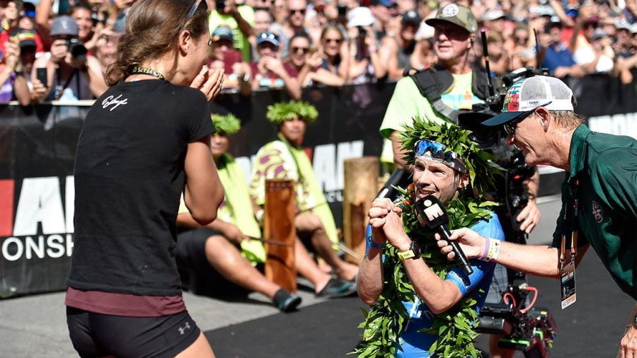 Patrick Lange of Germany proposes to his girlfriend Julia Hofmann after Lange sets a course record of 7:52:39 to win the IRONMAN World Championship brought to you by Amazon on October 13, 2018 in Kailua Kona, Hawaii. (Photo by Nils Nilsen/Getty Images for IRONMAN)