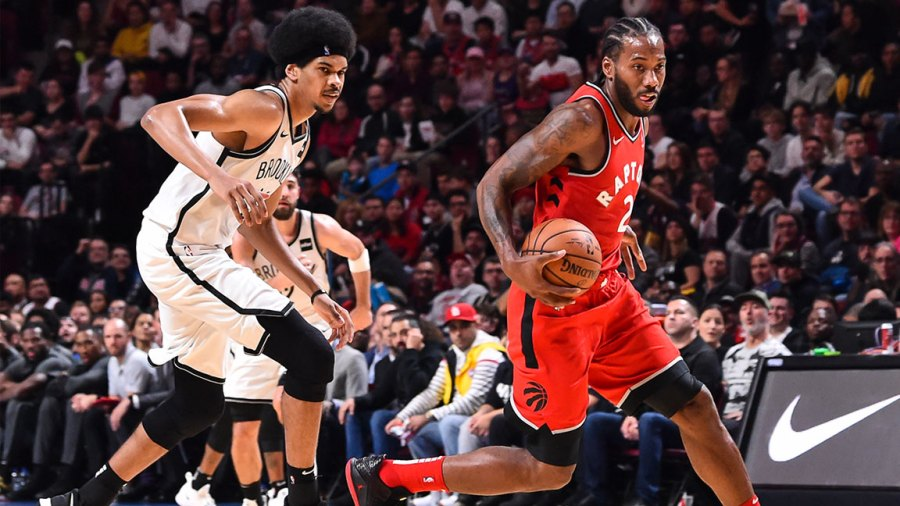 Kawhi Leonard #2 of the Toronto Raptors dribbles the ball past Jarrett Allen #31 of the Brooklyn Nets during the pre-season NBA game at the Bell Centre on October 10, 2018 in Montreal, Quebec, Canada. The Toronto Raptors defeated the Brooklyn Nets 118-91.