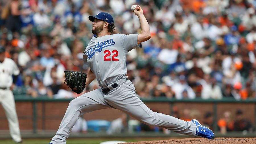 Clayton Kershaw #22 of the Los Angeles Dodgers pitches in the bottom of the first inning against the San Francisco Giants at AT&T Park on September 29, 2018 in San Francisco, California. (Photo by Lachlan Cunningham/Getty Images)
