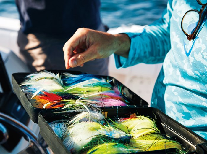 Selecting lures in the early morning light.