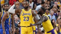 LeBron James #23 and Lance Stephenson #6 of the Los Angeles Lakers celebrate after James made a shot against the Golden State Warriors and was fouled during their preseason game at T-Mobile Arena on October 10, 2018 in Las Vegas, Nevada. The Lakers defeated the Warriors 123-113.