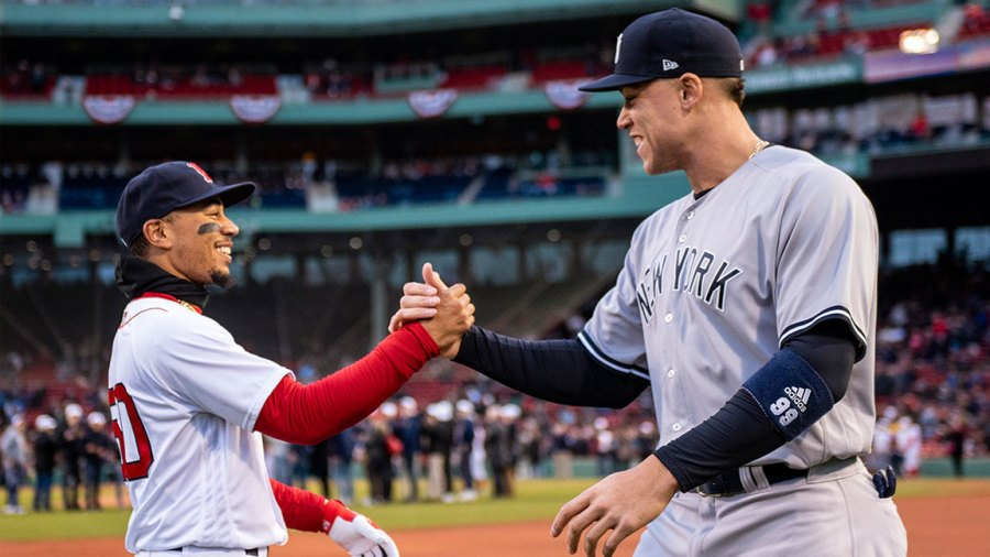 Mookie Betts #50 of the Boston Red Sox high fives Aaron Judge #99 of the New York Yankees before a game on April 11, 2018 at Fenway Park in Boston, Massachusetts. (Photo by Billie Weiss/Boston Red Sox/Getty Images)