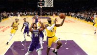 LeBron James #23 of the Los Angeles Lakers scores a basket against Marvin Bagley III #35 of the Sacramento Kings during the first half at Staples Center on October 4, 2018 in Los Angeles, California.