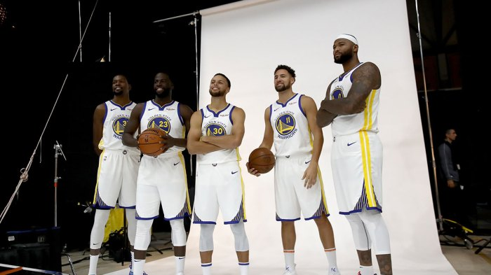 Kevin Durant #35, Draymond Green #23, Stephen Curry #30, Klay Thompson #11, and DeMarcus Cousins #0 of the Golden State Warriors pose for a group picture during the Golden State Warriors media day on September 24, 2018 in Oakland, California. (Photo by Ezra Shaw/Getty Images)