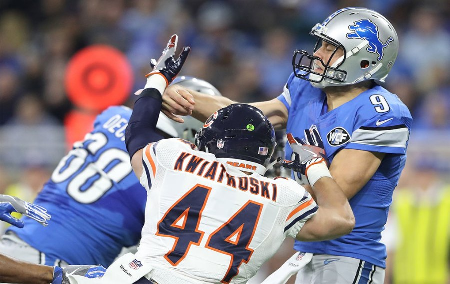 Quarterback Matthew Stafford #9 of the Detroit Lions is hit by Nick Kwiatkoski #44 of the Chicago Bears during second quarter action at Ford Field on December 11, 2016 in Detroit, Michigan. (Photo by Leon Halip/Getty Images)