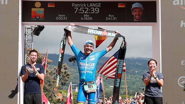 Patrick Lange of Germany celebrates after setting a course record of 7:52:39 to win the IRONMAN World Championships brought to you by Amazon on October 13, 2018 in Kailua Kona, Hawaii. (Photo by Al Bello/Getty Images for IRONMAN)