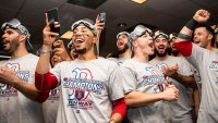 J.D. Martinez #28, Mookie Betts #50, Matt Barnes #32, Brock Holt #12, Brandon Workman #44, Rick Porcello #22, Joe Kelly #56, and Sandy Leon #3 of the Boston Red Sox celebrate in the clubhouse after clinching the American League Championship Series in game five against the Houston Astros on October 18, 2018 at Minute Maid Park in Houston, Texas. (Photo by Billie Weiss/Boston Red Sox/Getty Images)