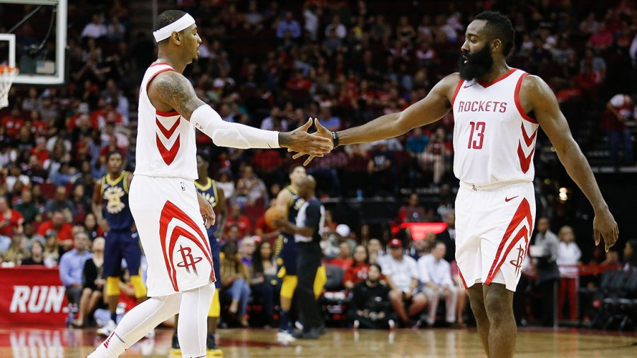 James Harden #13 of the Houston Rockets shakes hands with Carmelo Anthony #7 against the Indiana Pacers at Toyota Center on October 4, 2018 in Houston, Texas.