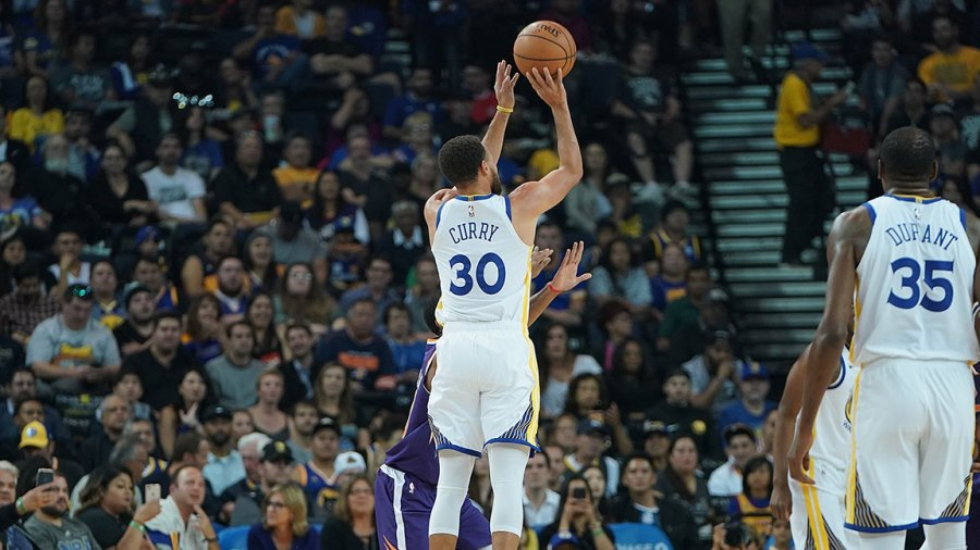 Stephen Curry #30 of the Golden State Warriors shoots a three-point shot against the Phoenix Suns during an NBA basketball game at ORACLE Arena on October 8, 2018 in Oakland, California.