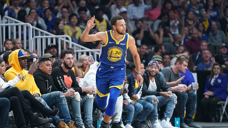 Stephen Curry #30 of the Golden State Warriors celebrates after scoring a three-point basket against the Los Angeles Lakers during the first half of their NBA preseason basketball game at SAP Center on October 12, 2018 in San Jose, California.