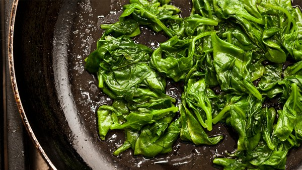 fresh sauted spinach on a pan